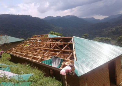 Roofing the second block of the Gorilla Health and Community Conservation Center